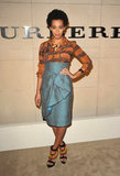 For an October 2011 Burberry event, Solange sported a button-down blouse and draped pencil skirt from the brand, as well as a pair of its Verulam beaded sandals.