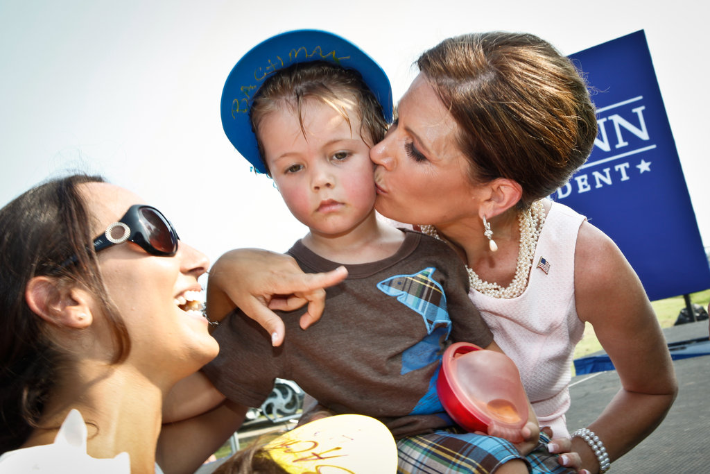 Before she left the race, Michele Bachmann kisses a little boy at a rally in South Carolina.