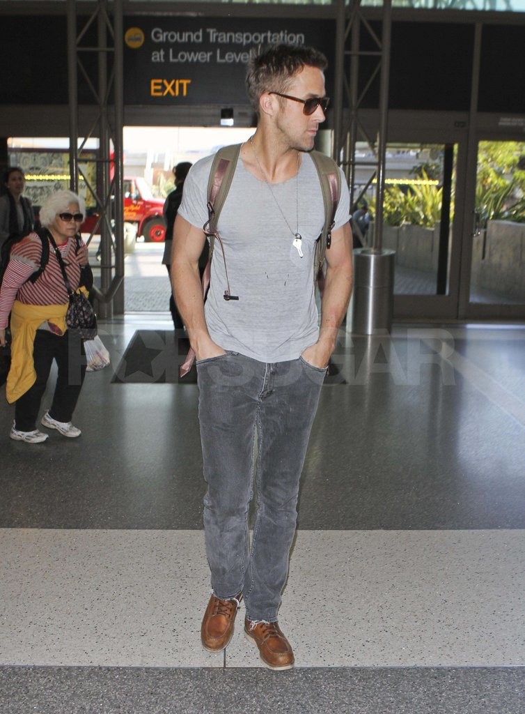 Hot Ryan Gosling wearing sunglasses at LAX.