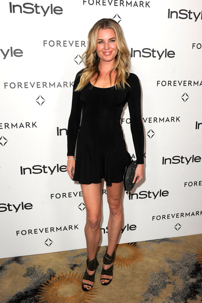 Rebecca Romijn flaunted her stems in a black, skater-style dress and strappy heels.