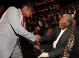 Cuba Gooding Jr. shakes hands with Morgan Freeman.