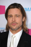 Brad Pitt wearing a white tie.