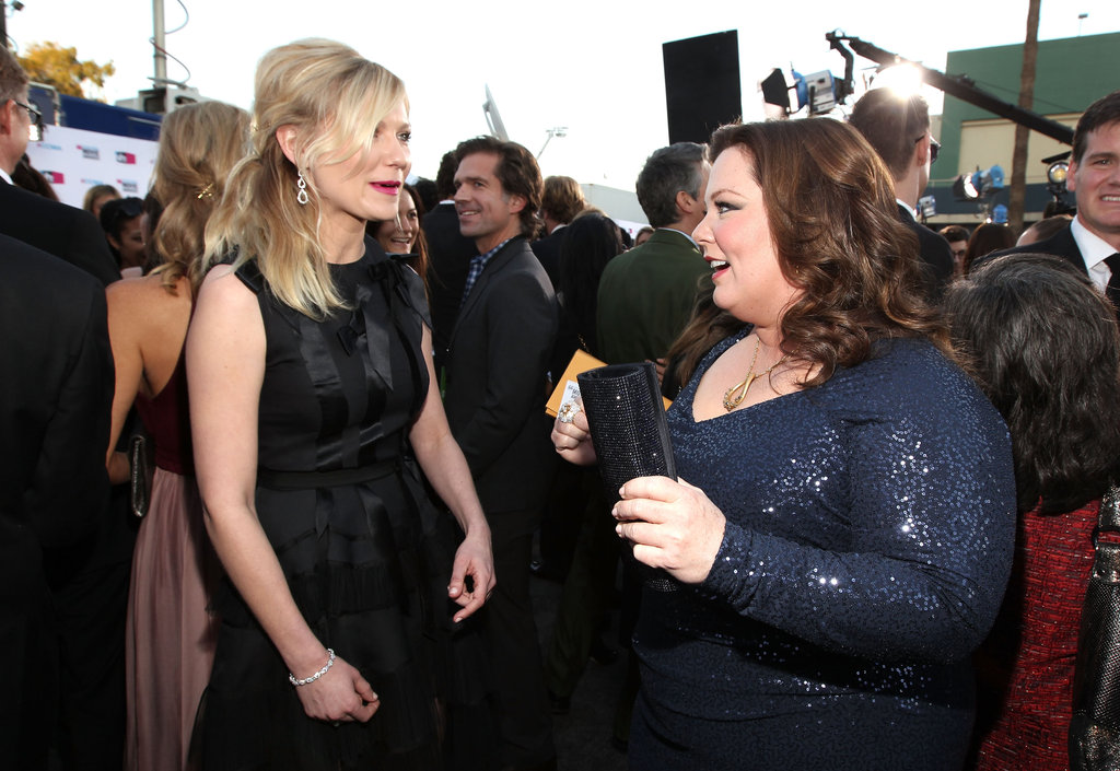Kirsten Dunst and Melissa McCarthy share a moment at the Critics' Choice Awards.