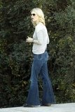 January Jones in flare jeans.