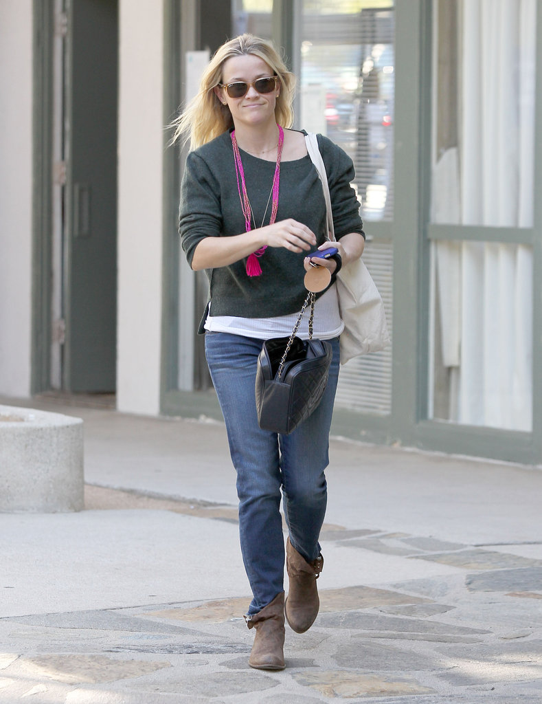 Reese Witherspoon was happy on her way home from the office.