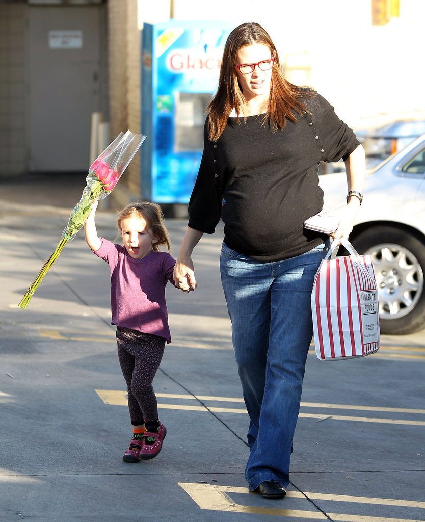 Seraphina Affleck held pregnant Jennifer Garner's hand while she skipped with a bouquet of flowers.