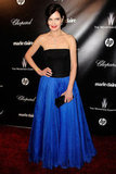 Elizabeth McGovern in a black and blue ball gown.