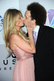 Josh Sussman and Tess Hunt show off their love at the NBC Universal party.