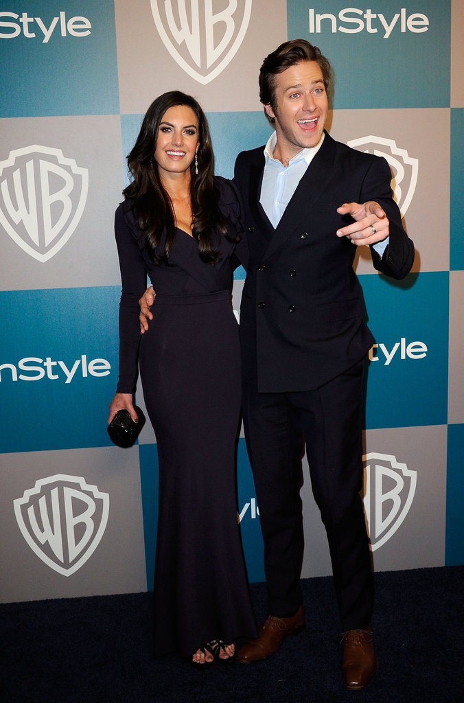 Armie Hammer keeps his arm around Elizabeth Chambers.