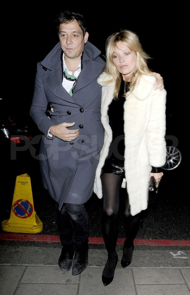 Kate Moss and Jamie Hince had their arms wrapped around one another in London.