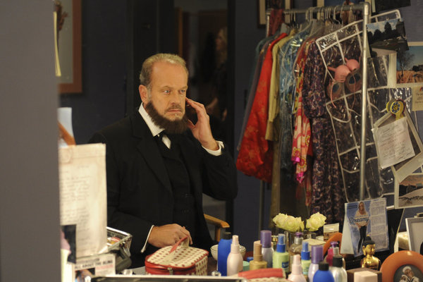 An Abraham Lincoln-looking Kelsey Grammer (playing himself) gets acquainted with that serious beard.  Photo courtesy of NBC