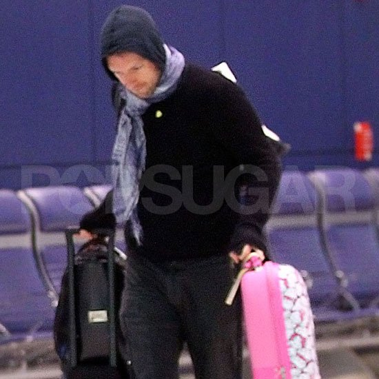 Chris Martin carried his daughter's bags.