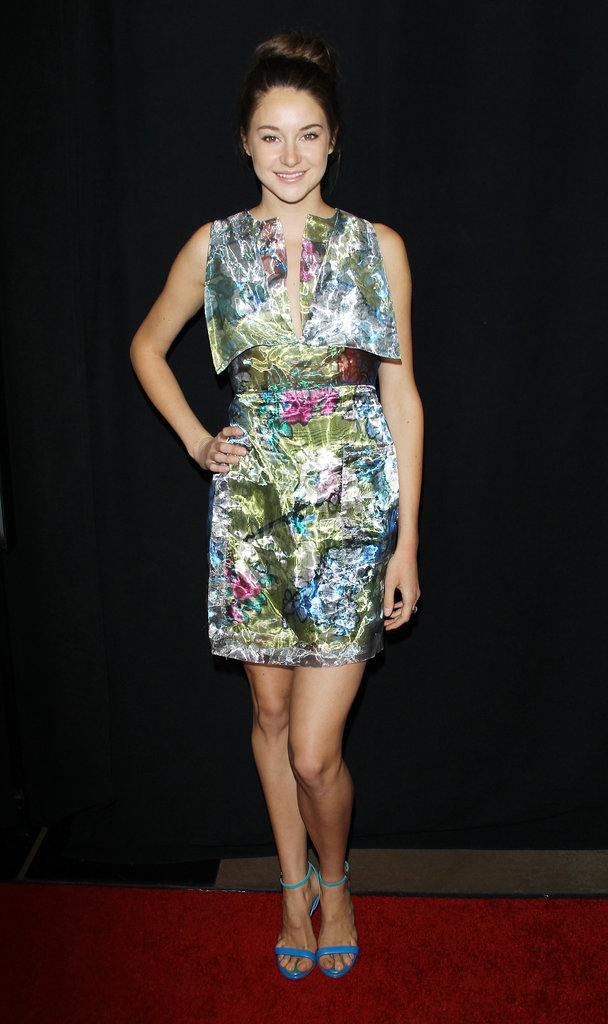 Shailene wore an iridescent Christopher Kane dress in a pretty, abstract floral print with a sexy open back. She paired the mini with a beautiful pair of bright blue Ferragamo sandals for the perfect pop of color.
