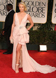 Charlize Theron lit up the Golden Globes red carpet in the most feminine, romantic Christian Dior Couture gown.