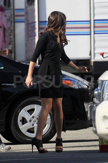 Lea Michele walked onto set in high heels.