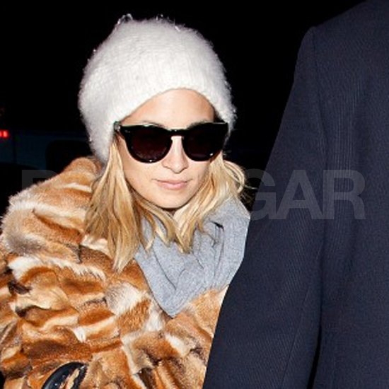 Nicole Richie wore sunglasses as she took off from LAX.