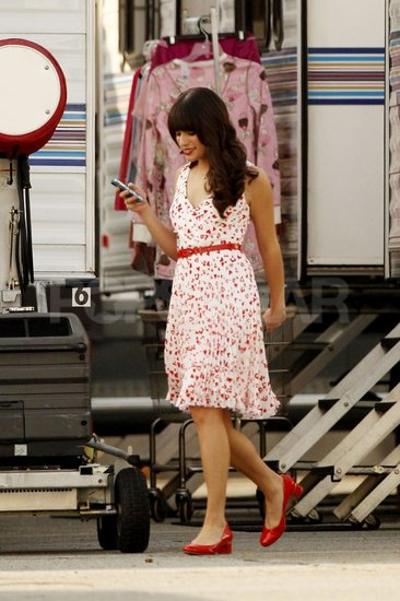 Lea Michele topped off her floral-print dress with red flats and a red belt on the set of Glee.