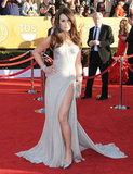 Lea Michele went for all-out sex appeal at the SAG Awards in a draped Versace gown with a thigh-high slit. She finished the sultry look with Casadei pumps, Lorraine Schwartz jewels, and a Fendi clutch.
