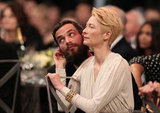 Tilda Swinton shows some affection to her man.