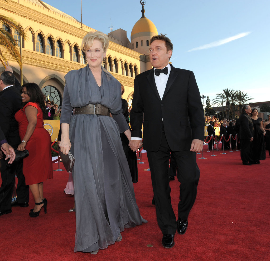 Meryl Streep and her hubby walk hand in hand.