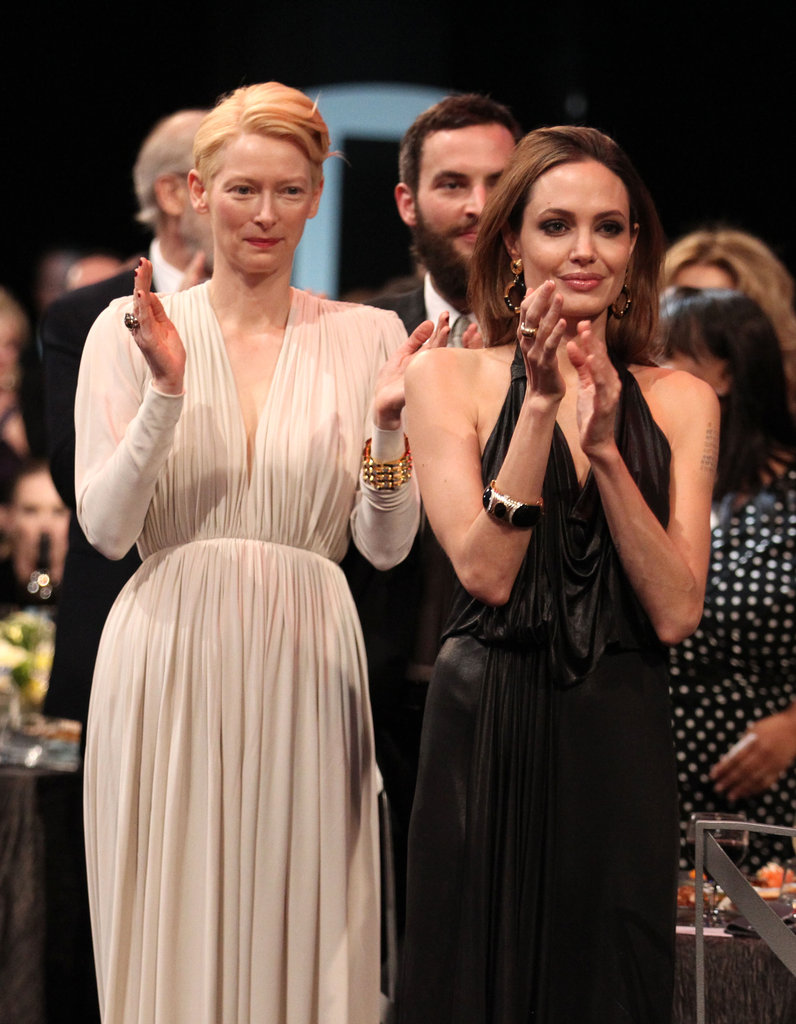 Angelina joins Tilda for a standing ovation.