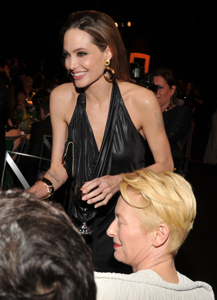 Angelina Jolie and Tilda Swinton crack up.