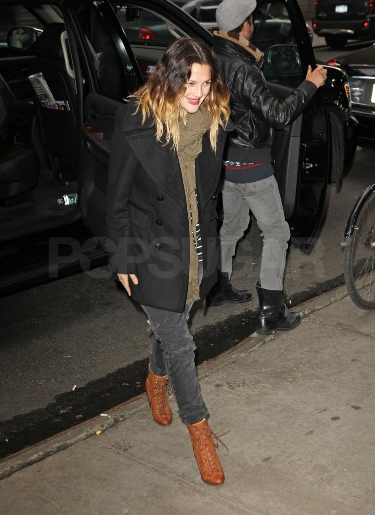 Drew paired a black jacket with her brown boots to stay warm in NYC.