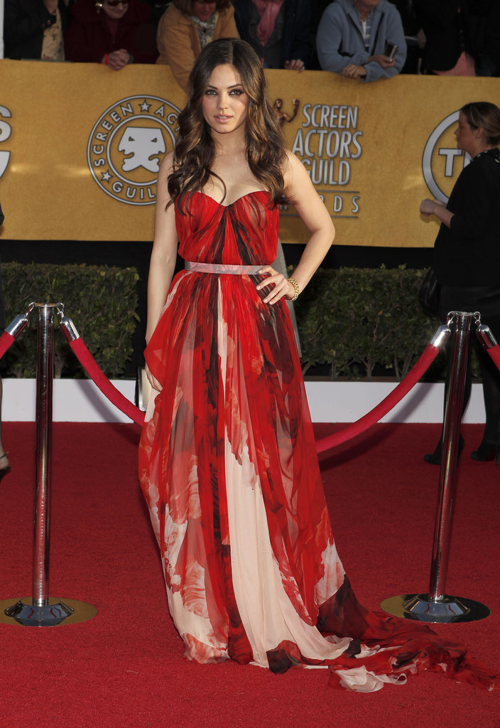 Mila Kunis channeled sexy siren in a diaphanous crimson Alexander McQueen gown at the 2011 awards.