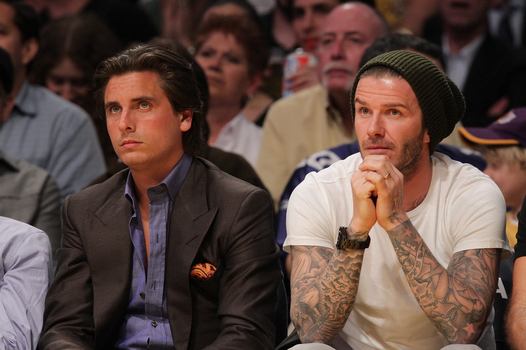 David Beckham sat next to a bored-looking Scott Disick.