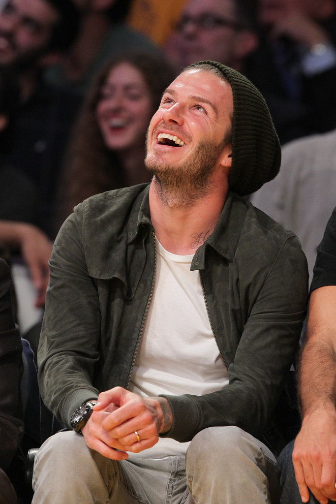 David Beckham laughed during the Lakers game.