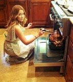 Who knew LC could cook? Here she is basting a turkey. Source: Twitter user laurenconrad