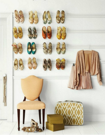 If you love shoes but struggle to find your favorites in the shuffle of your closet, try displaying them on crown molding. It's a great way to bring your beautiful formal heels — the ones you rarely have a chance to wear — into your everyday decor. Source