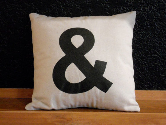 For a cheeky, subtle touch of typography, toss the Ampersand Pillow ($25) on your couch. In simple black and white, it's sure to match any decor.