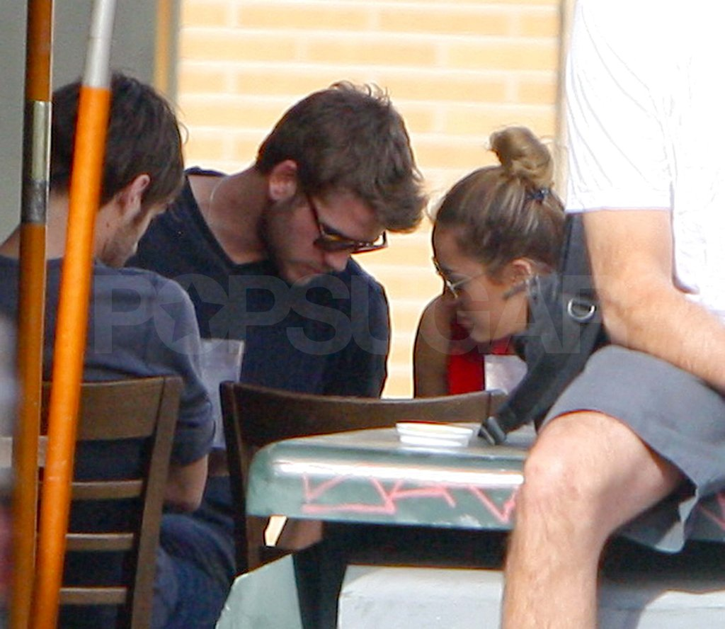 Miley Cyrus and Liam Hemsworth chatted over lunch in LA.