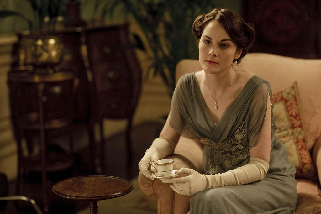"Ever notice how nobody wears her hair down at Downton Abbey? That's not by accident. Only little girls and ""loose"" women wore their hair down in those days. Wearing hair up, however, showed that she was ready to be presented — and therefore, courted — as a grown woman."