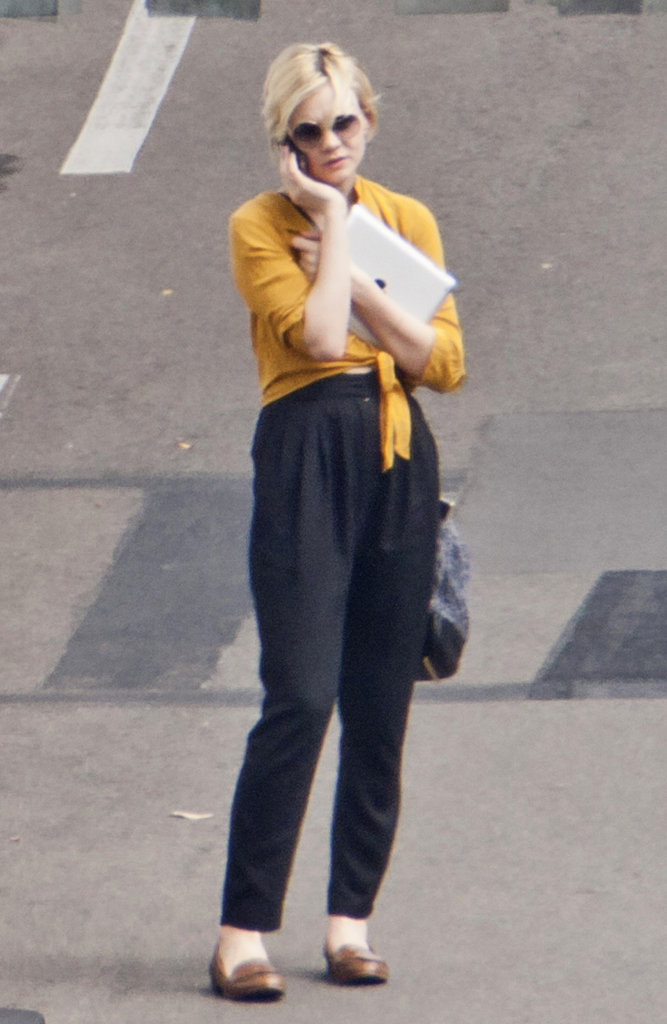 Carey Mulligan wearing yellow in Australia.