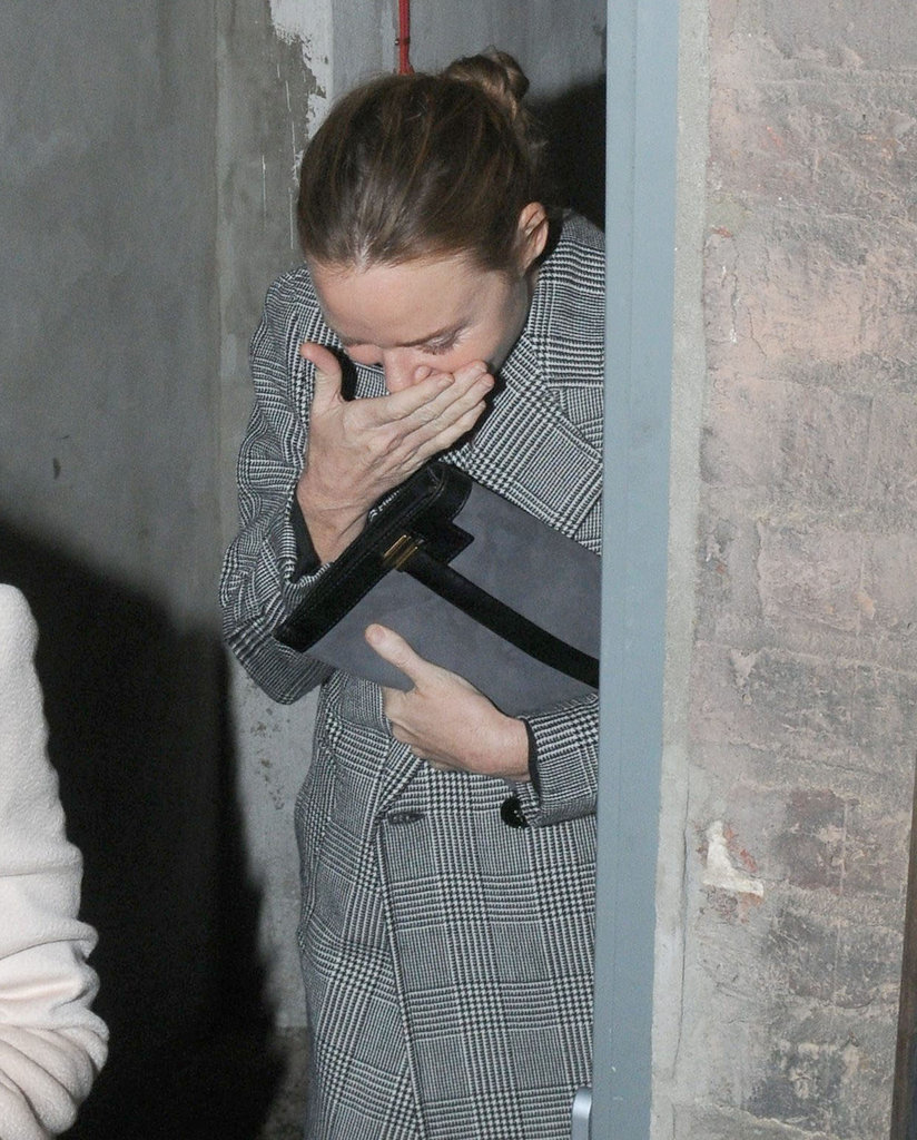 Stella McCartney laughed on her way out of a bar.