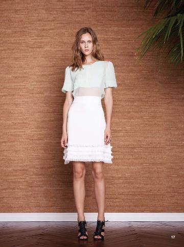 Minty green and a white skirt — what a pretty combo.