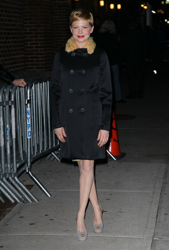 Michelle Williams wore a double-breasted coat with a fur collar.