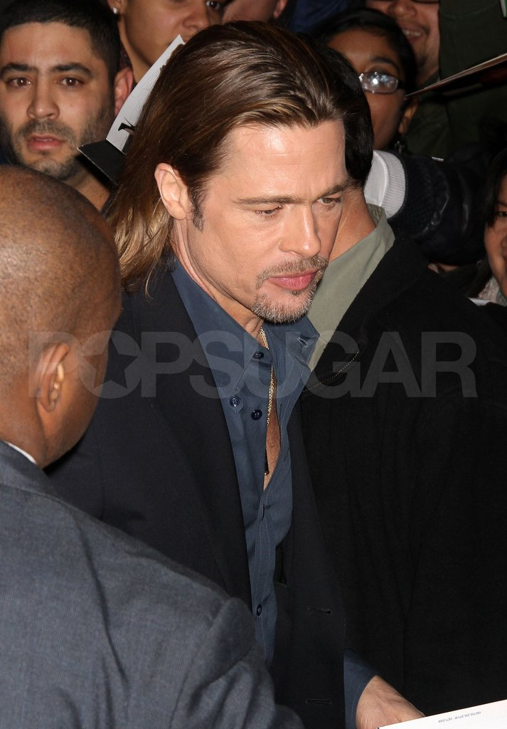 Brad Pitt signed autographs for fans.