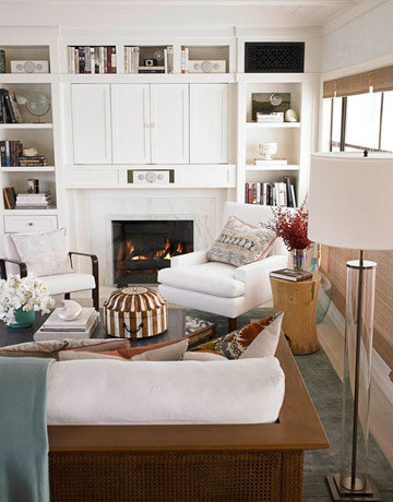 A different take on the flat screen over the fireplace, these cabinets hide electronics while the surrounding decorative shelving camouflages speakers among books and other knickknacks. Source