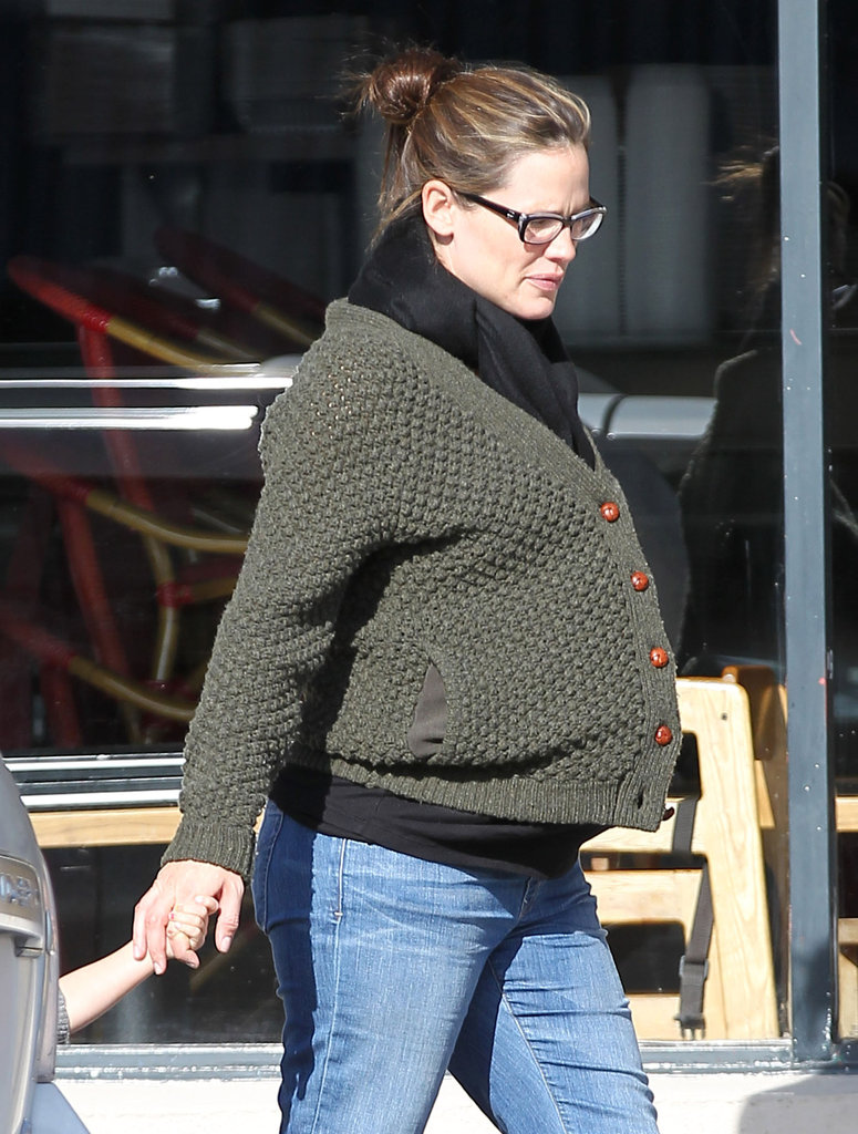Jen kept warm in a cozy, green sweater.