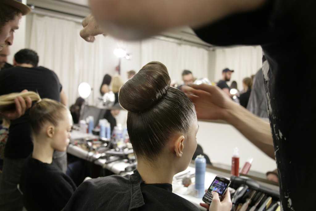 John Frieda global creative consultant Luigi Murenu created the impressive updos by applying the brand's Frizz-Ease Lightweight Frizz Control and brushing hair into high ponytails. Photo: Megan Holmes