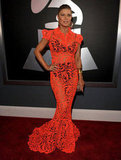 Fergie wore a hot orange gown to the Grammys.