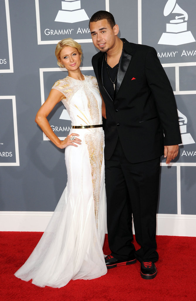 Paris Hilton accompanies DJ Afrojack on the red carpet.