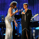 Cousins Dionne Warwick and Whitney Houston perform at Clive Davis's pre-Grammy party last year.