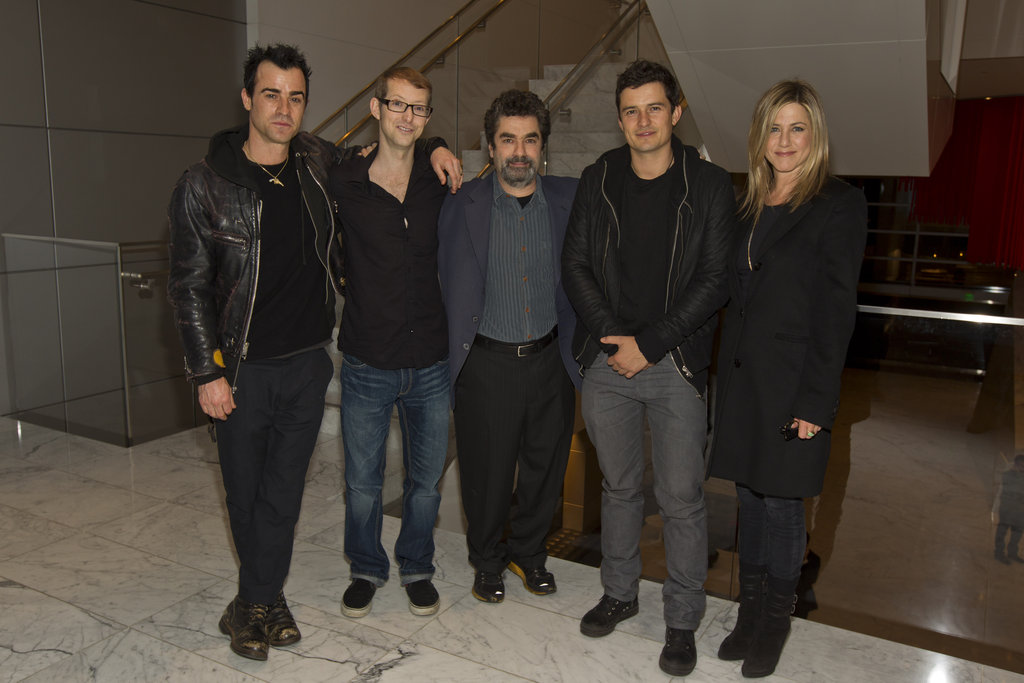 Jennifer Aniston and Justin Theroux stood at opposite ends of a photo lineup with Orlando Bloom, Jason Baldwin, and Joe Berlinger at a screening of HBO's Paradise Lost 3: Purgatory on a chilly January night in LA.