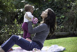 Kristin Davis and Gemma Davis cuddled in a park.