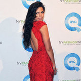 Camila Alves in a red dress at QVC's runway presentation.