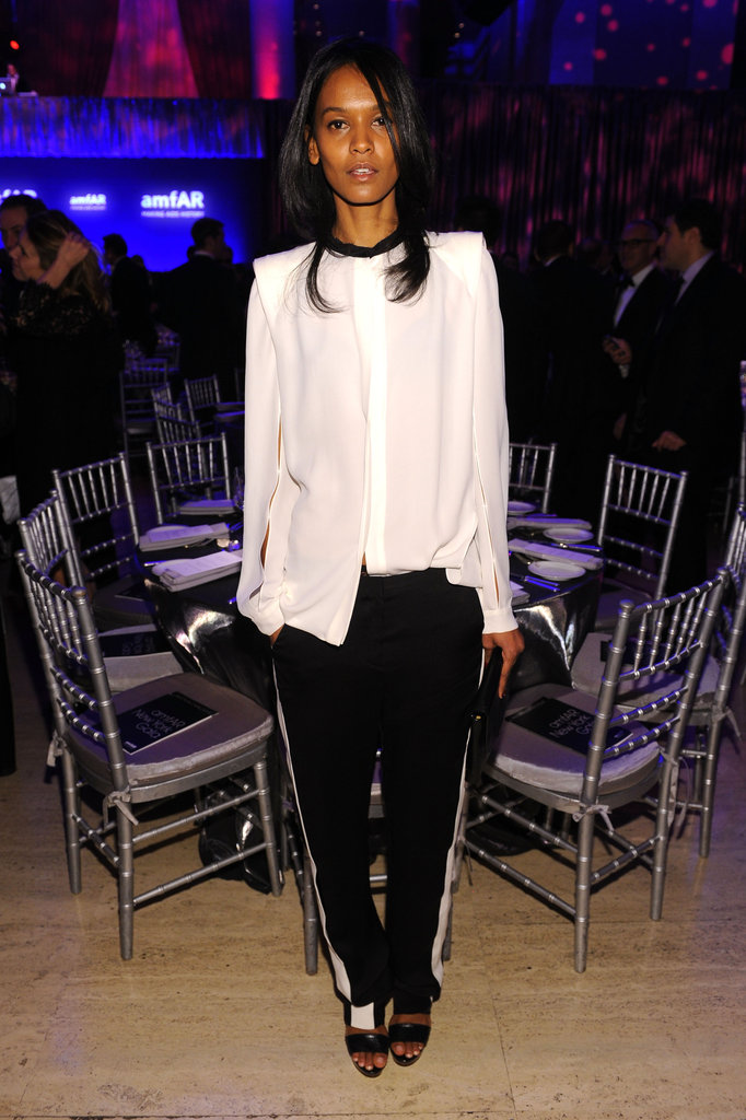 Model Liya Kebede rocked a sportier tuxedo-inspired ensemble, pairing a two-tone structured blouse with slouchy tuxedo pants.